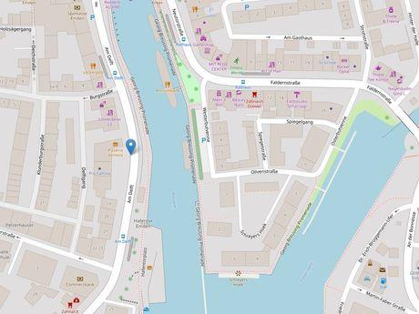 Zu sehen ist ein Kartenausschnitt von Open Streetmap, welcher den Standort des Parkplatzes in der Straße Am Delft anzeigt